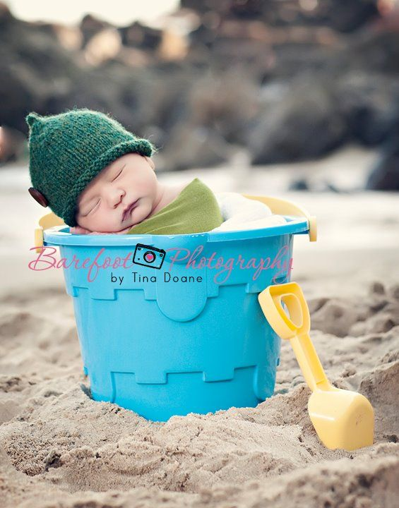 Bucket and spade newborn at the beach seaside