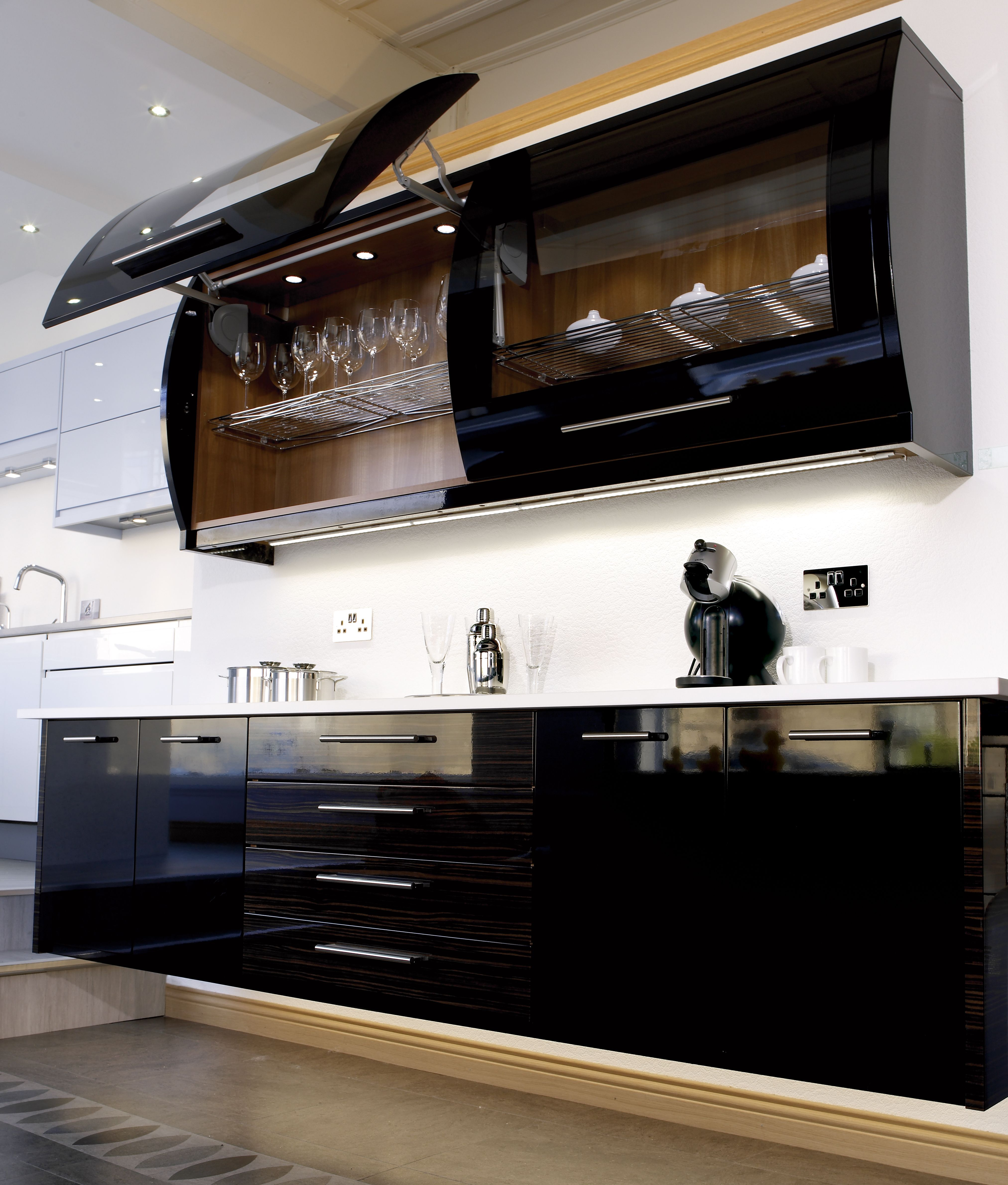 Use Flexible Strip Above And Beneath Kitchen Cabinets To