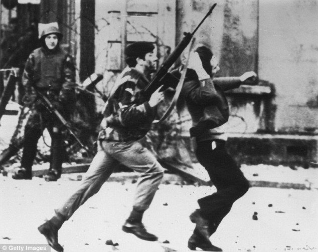 An armed soldier attacks a protester on Bloody Sunday when British Paratroopers shot dead 13 civilians on a civil rights march in Derry on January 30, 1972