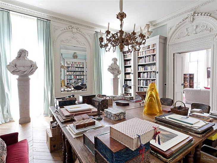 This dining room is also used as a library. Notice they used four tables to create a large one