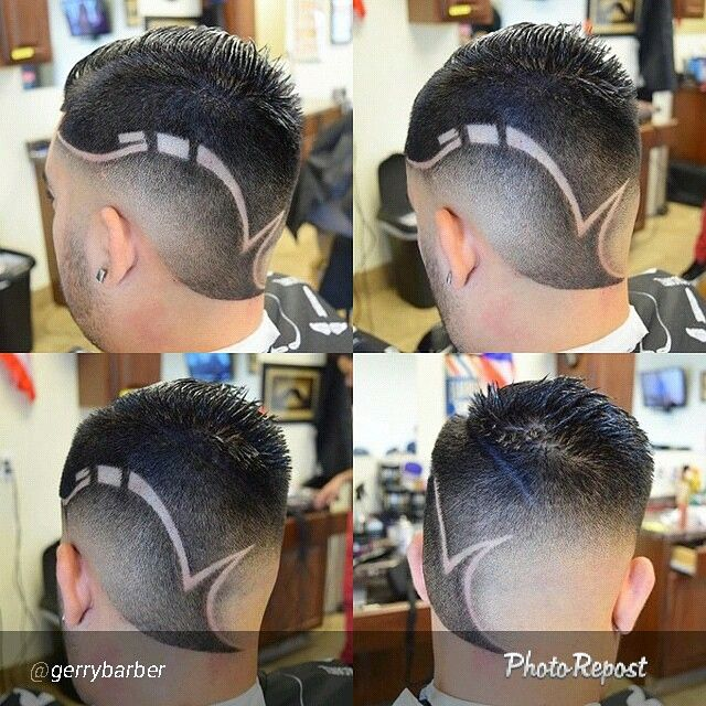 Skin Fade haircut with a custom design performed by @gerrybarber  www.nationalbarbersassociation.com