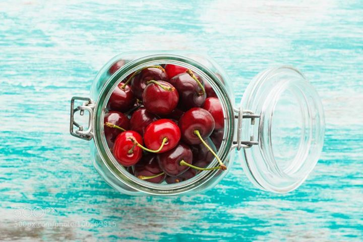 Glass bank with cherries inside
