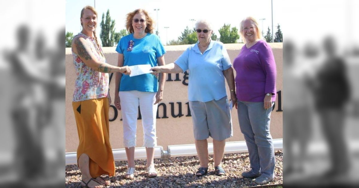 woman s club of rock springs presents grant checks for college
