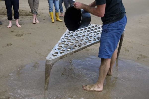 MAX LAMB constructs poured metal tables and stools using primitive sand casting techniques.    AMAZING : D