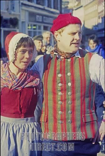 Danish folk dance couple in traditional dress visiting York , England , c . 1985 . Folk music . Bright colored costumes , red and green . stock photo