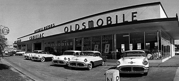 Oldsmobile Dealership With 1956 Cars On The Lot Chrome