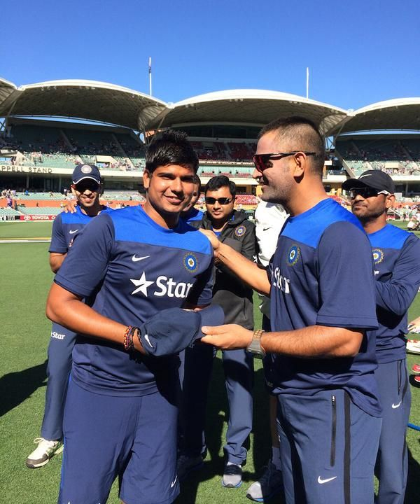 Image result for karn sharma with dhoni in test