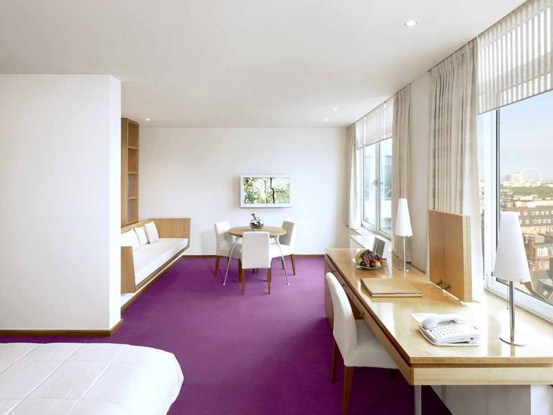 small studio apartment with purple carpet