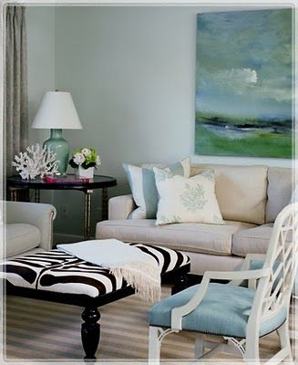 Coastal Chic Accents & Interiors...stick a surprising bold piece like the zebra ottoman that will spice up the whole look!
