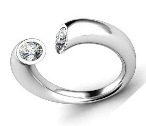 This is an odd one 0.75 ct Lady's Round Cut Diamond Unusual Wedding Band in 18 kt White Gold.