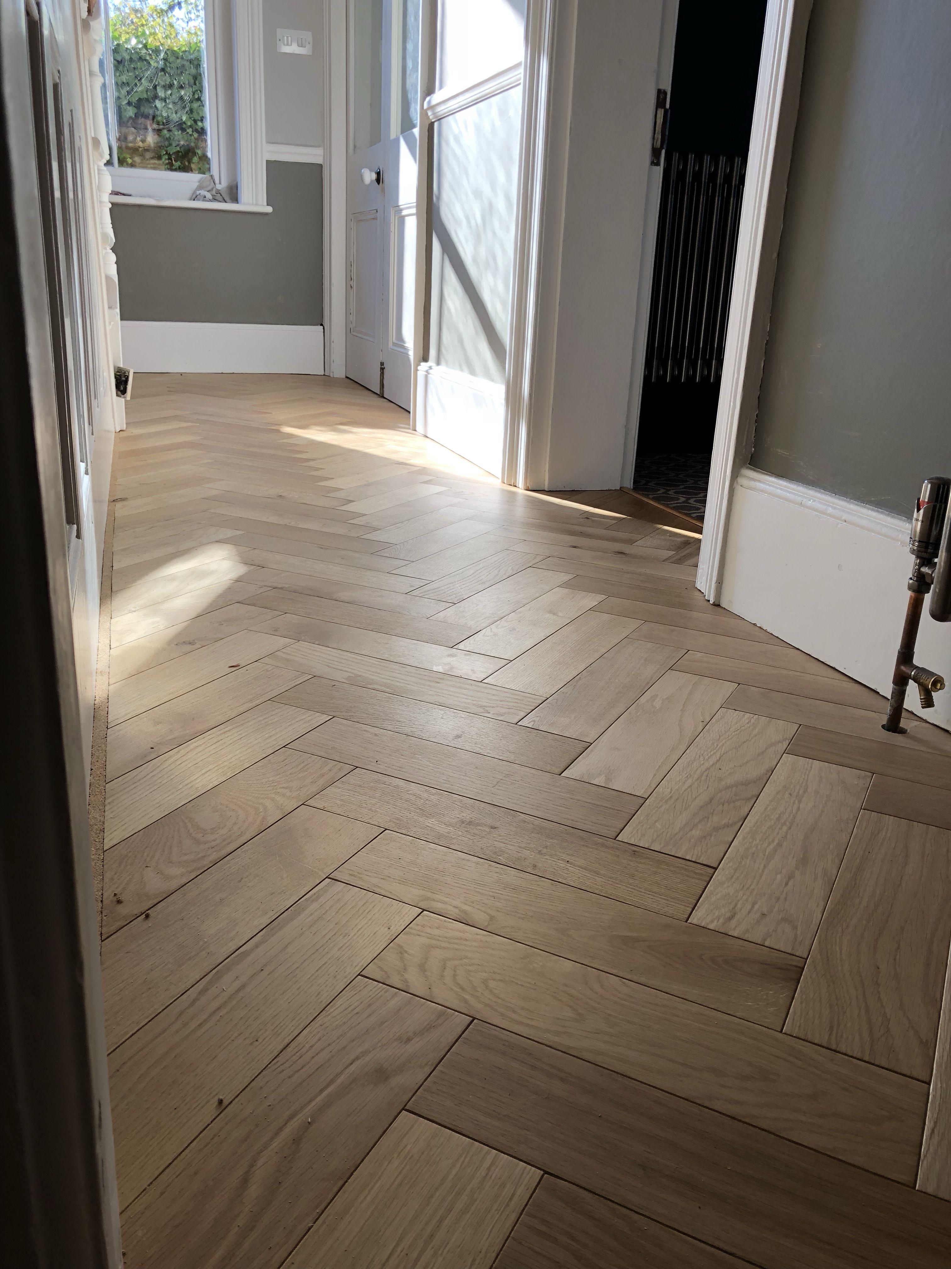 Oak Engineered wood blocks laid in a Herringbone design