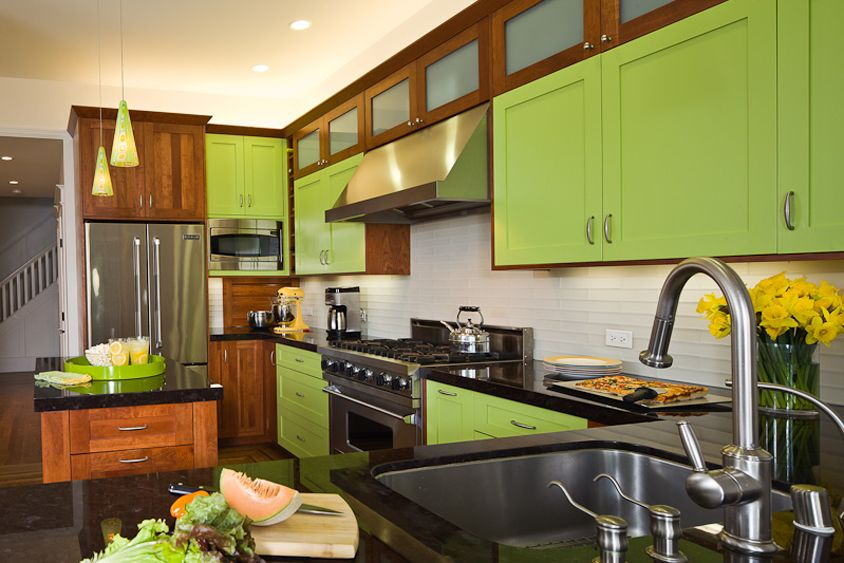 Lots of interesting things here. The wood and the green, the range hood with small cabinets above.