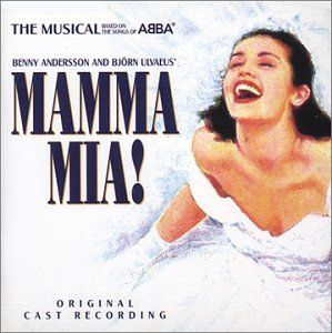 I've always loved the picture of the bride laughing on the Mamma Mia musical poster.  Turns out this is exactly how I felt on my wedding day.