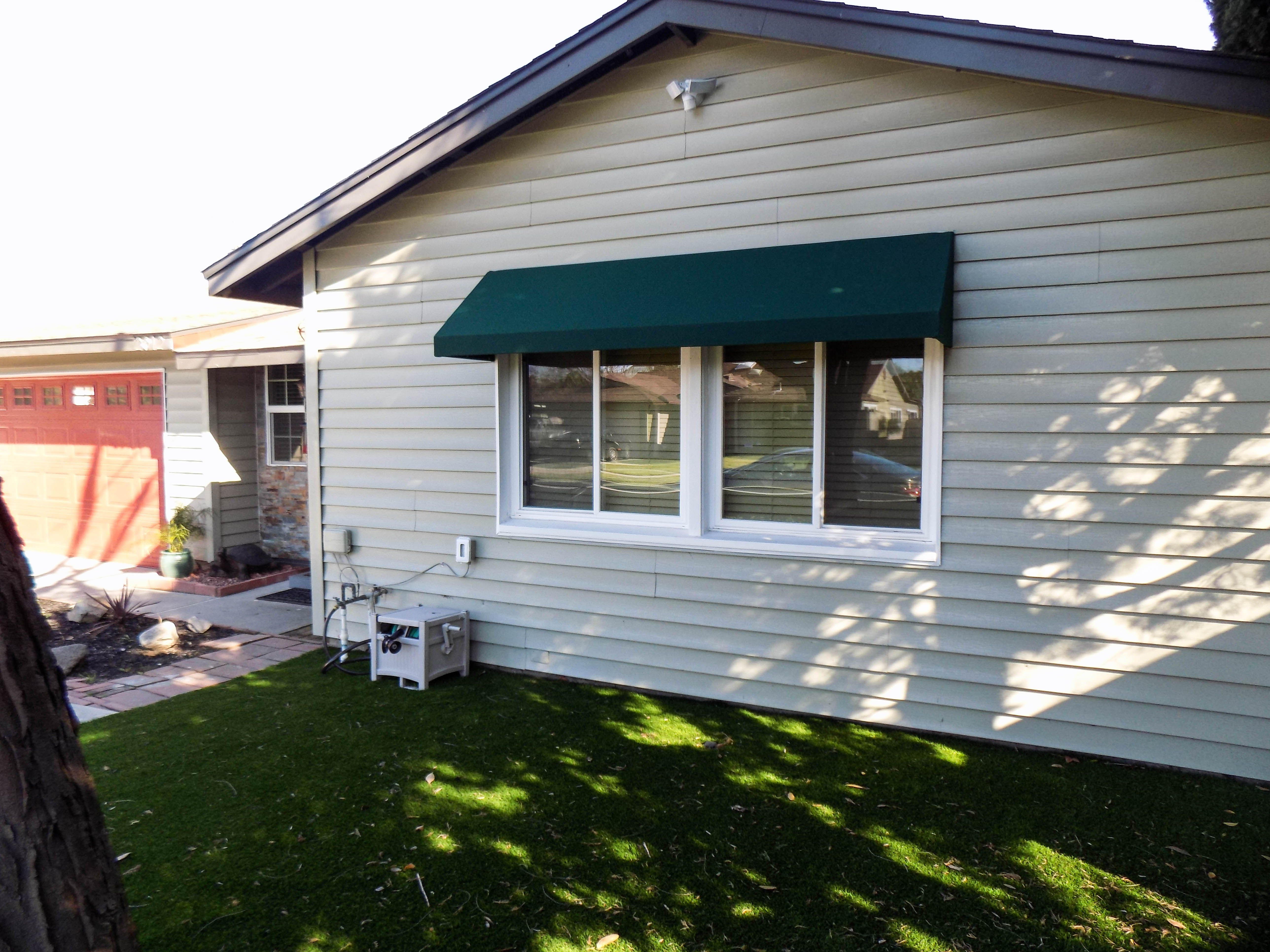 Add Shade To Your Windows While Also Adding Curb Appeal With A New Awning On This Particular Installation In Long Beach C Homeowner Curb Appeal Outdoor Decor