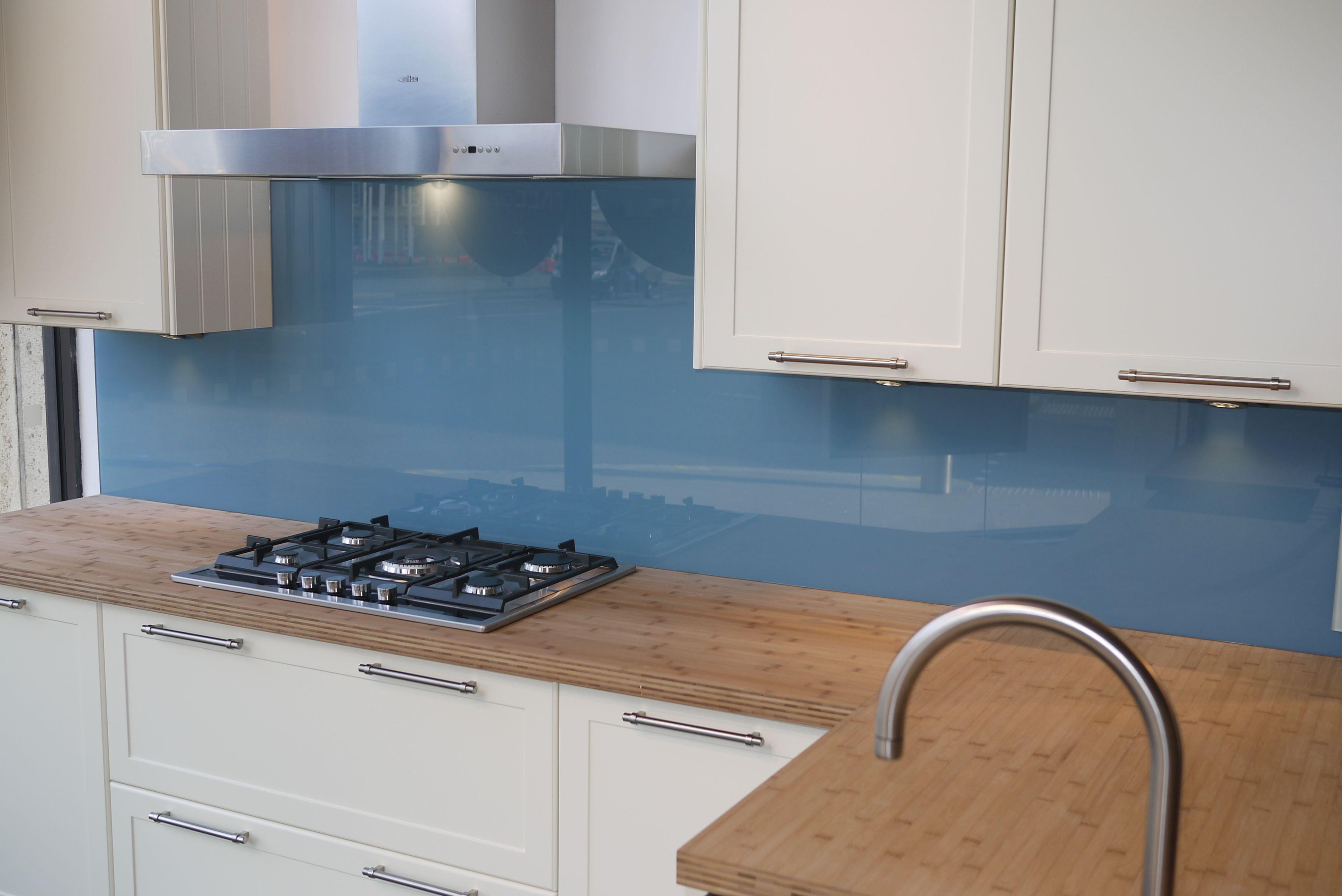 Pale blue glass splashback set against a natural block for Kitchen design kingston