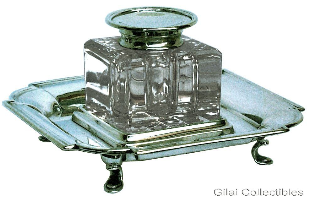 A 19th century cut glass inkwell on silver stand. click to enlarge