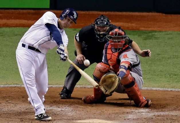 Tampa Bay Rays' Jose Lobaton hits a home run in front of Boston Red Sox catcher Jarrod Saltalamacchia in the ninth inning to win Game 3 of the ALDS at Tropicana, on Monday, Oct. 7, 2013. Tampa Bay Rays won 5-4. (Photo: John Raoux)