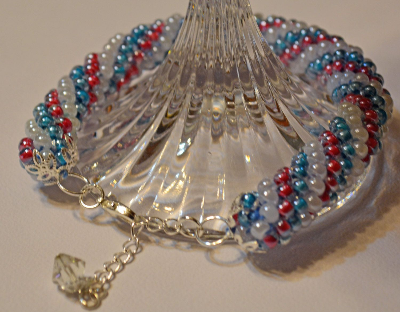 Crocheted Jewelry..Crochet beaded bracelet..Tubular spiral handmade beaded bracelet..red,white,blue..silver plated end caps, extender chain by BarbsBurntTree on Etsy