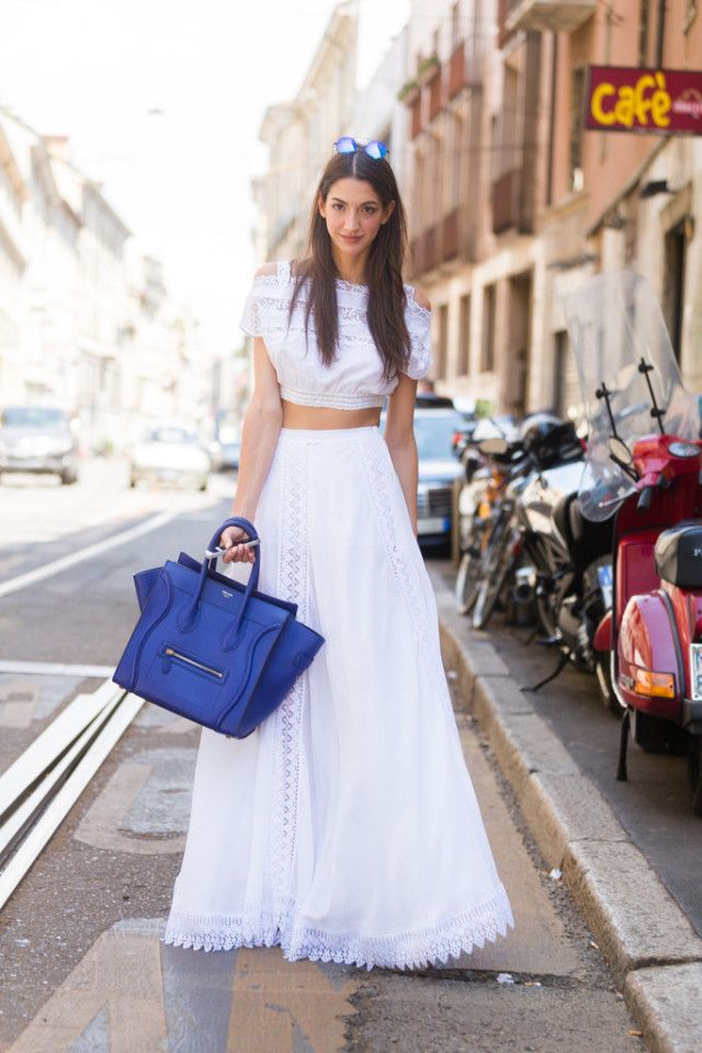 Summer street style fashion inspiration: A tummy-baring crop top helped  balance out the volume of a full maxi skirt.