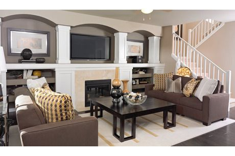 Pillars Frame Recessed Niches Above The Fireplace The