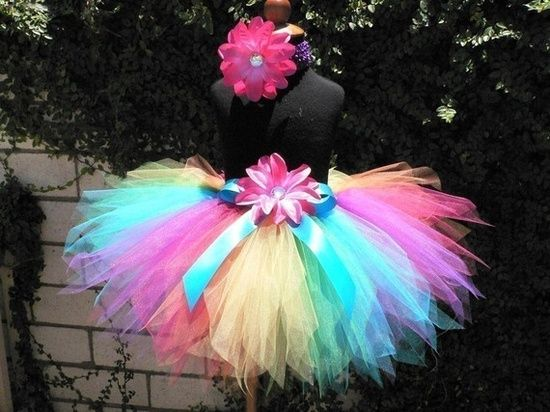 fe6e885619 DIY rainbow tutu tutorial. These are so cute and would be such an adorable  costume for little girls at the party!