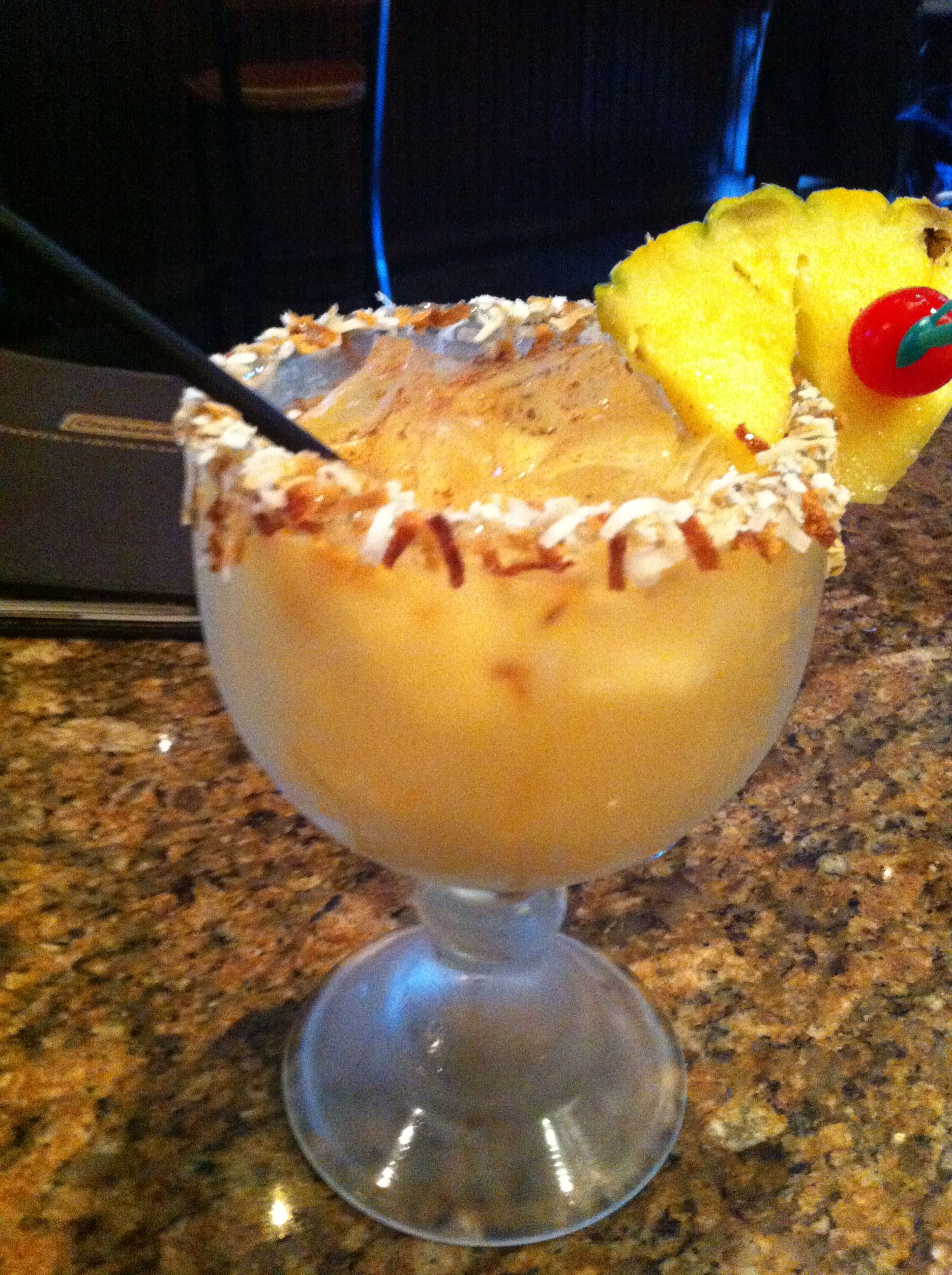 The Pain Killer from Cheddar's.   Painkiller drink recipe: Ingredients: 2 ounces Pusser's dark rum, 1 ounce cream of coconut, 4 ounces pineapple juice, 1 ounce orange juice, nutmeg. Directions: 1. Shake or stir ingredients, and pour over ice in a tall glass. Sprinkle nutmeg on top, and serve.