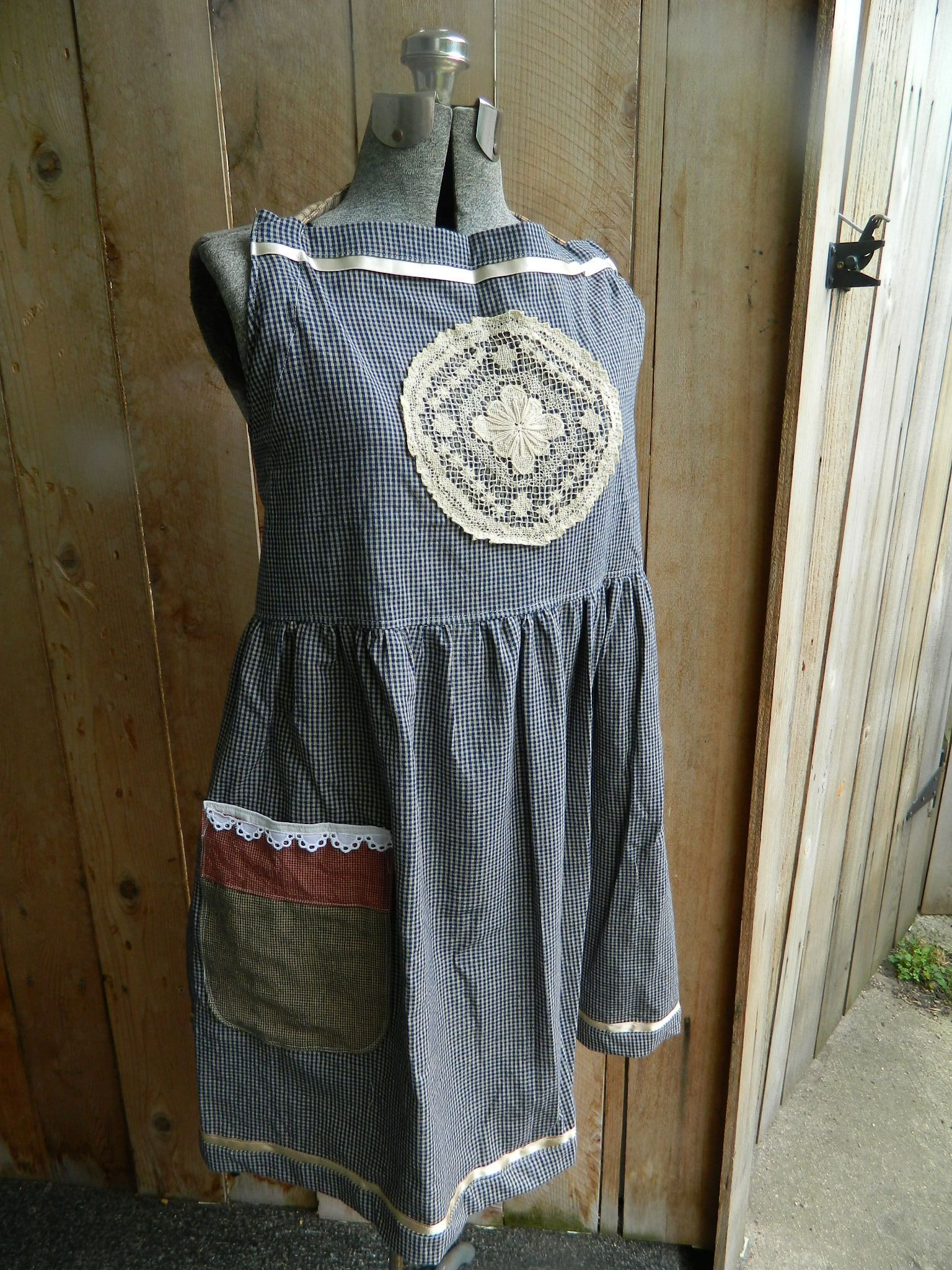 Blue home spun cotton with functional pocket, large crocheted medallion on bodice, lace and satin ribbon trim.  DoodleBerry Designs by Kathy $25