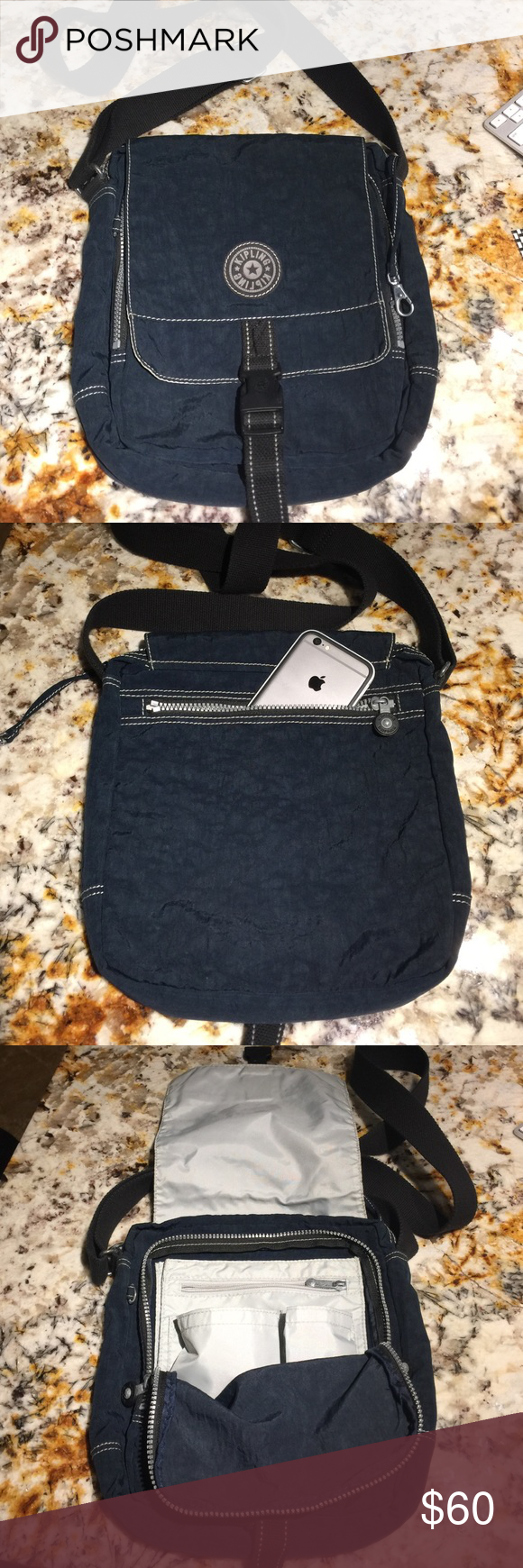 Kipling messenger crossbody bag Very nice & neat Kipling crossbody messenger bag navy blue looks like new ! Kipling Bags Crossbody Bags