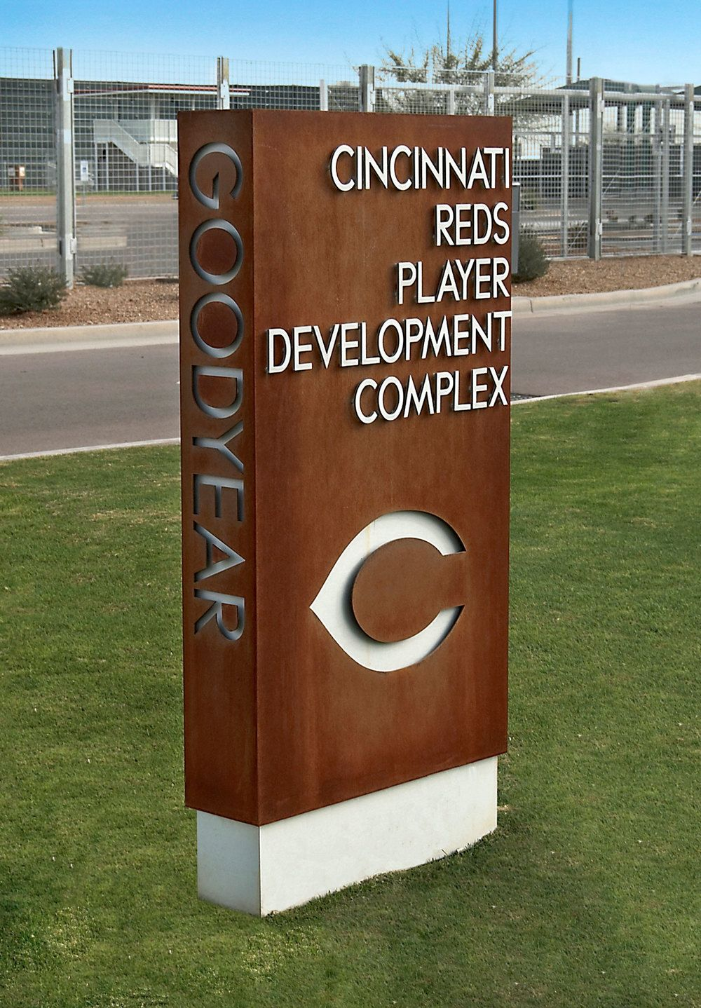 A freestanding monument constructed of water jet cut cor for Exterior signage design