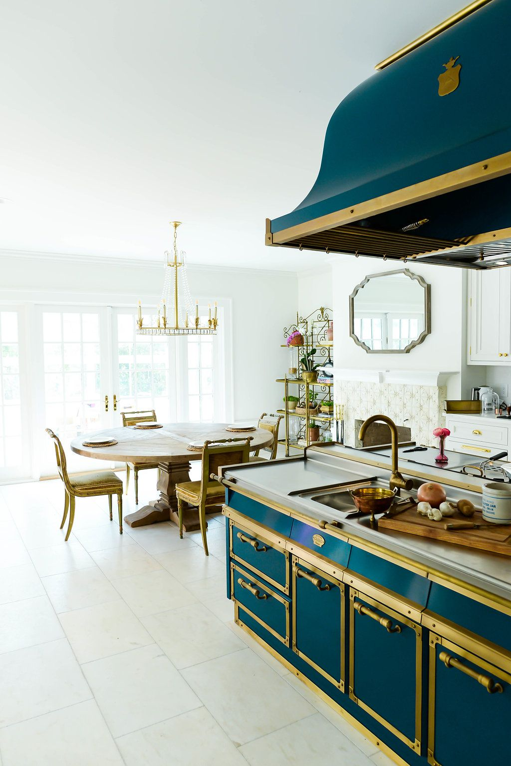 Elegant kitchen in blue and gold part of a custom home by Nelson ...