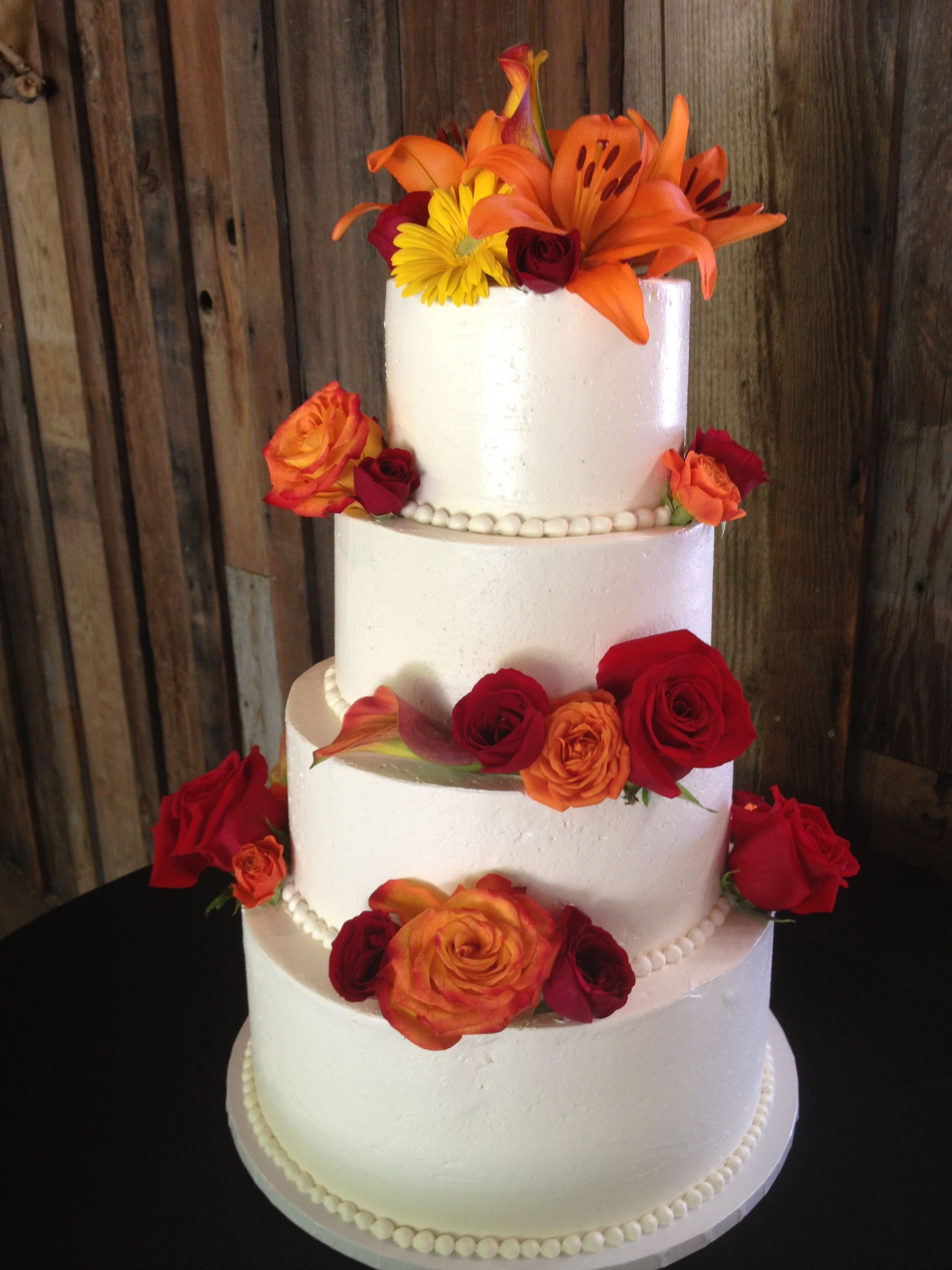 wedding bakeries in sacramento ca%0A Four tier buttercream wedding cake with fresh flowers  Cake and dessert by  Sugar and Spice