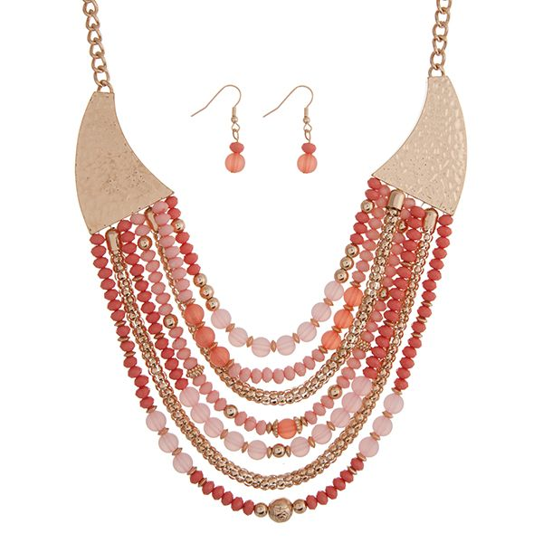 "#LyfeStyleFinds #fashionjewelry: Gold tone layering necklace set displaying rows of #pinkbeads hanging from a hammered casting. Approximately 23"" in length."