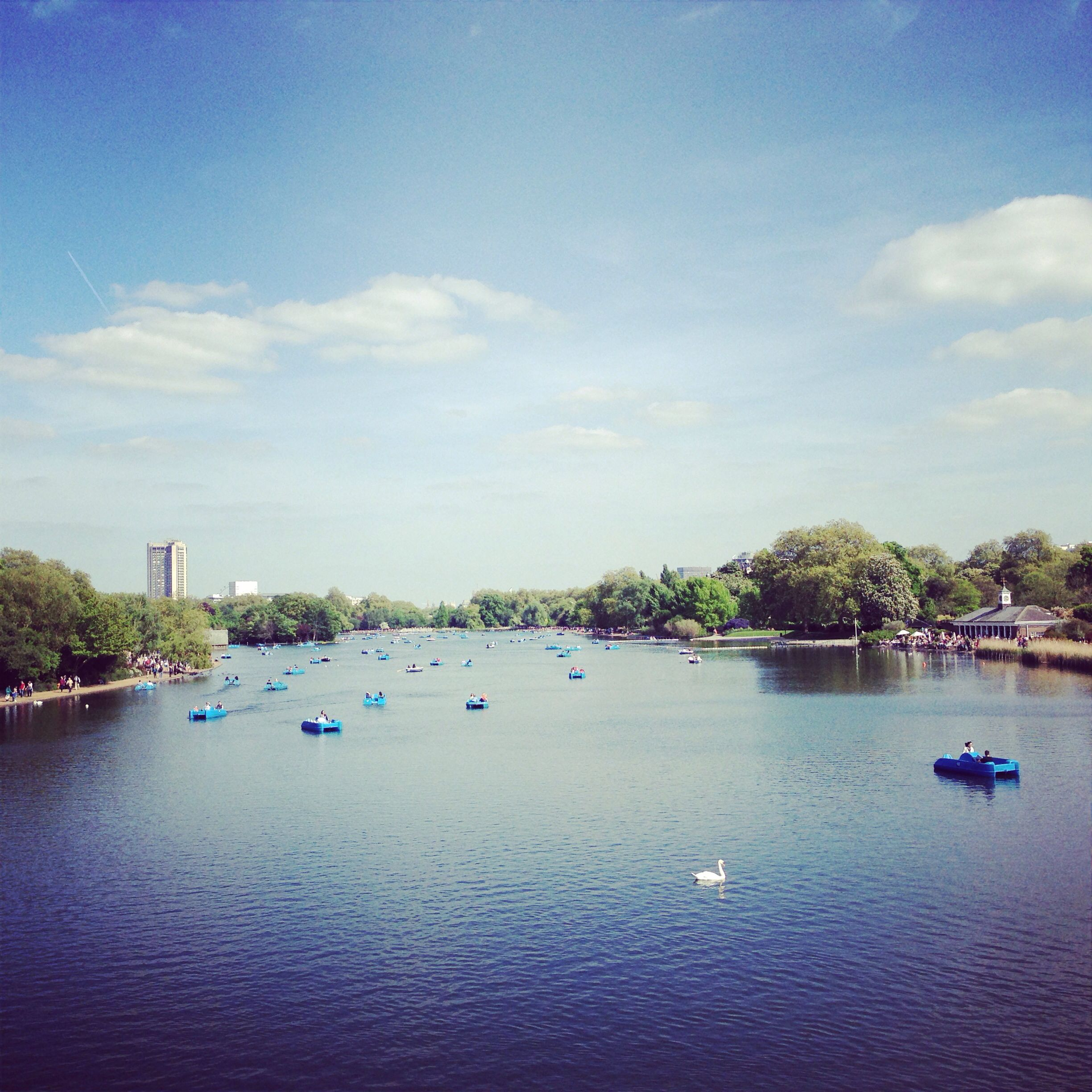 Yachting and sunbathing on the serpentine. Hyde park.
