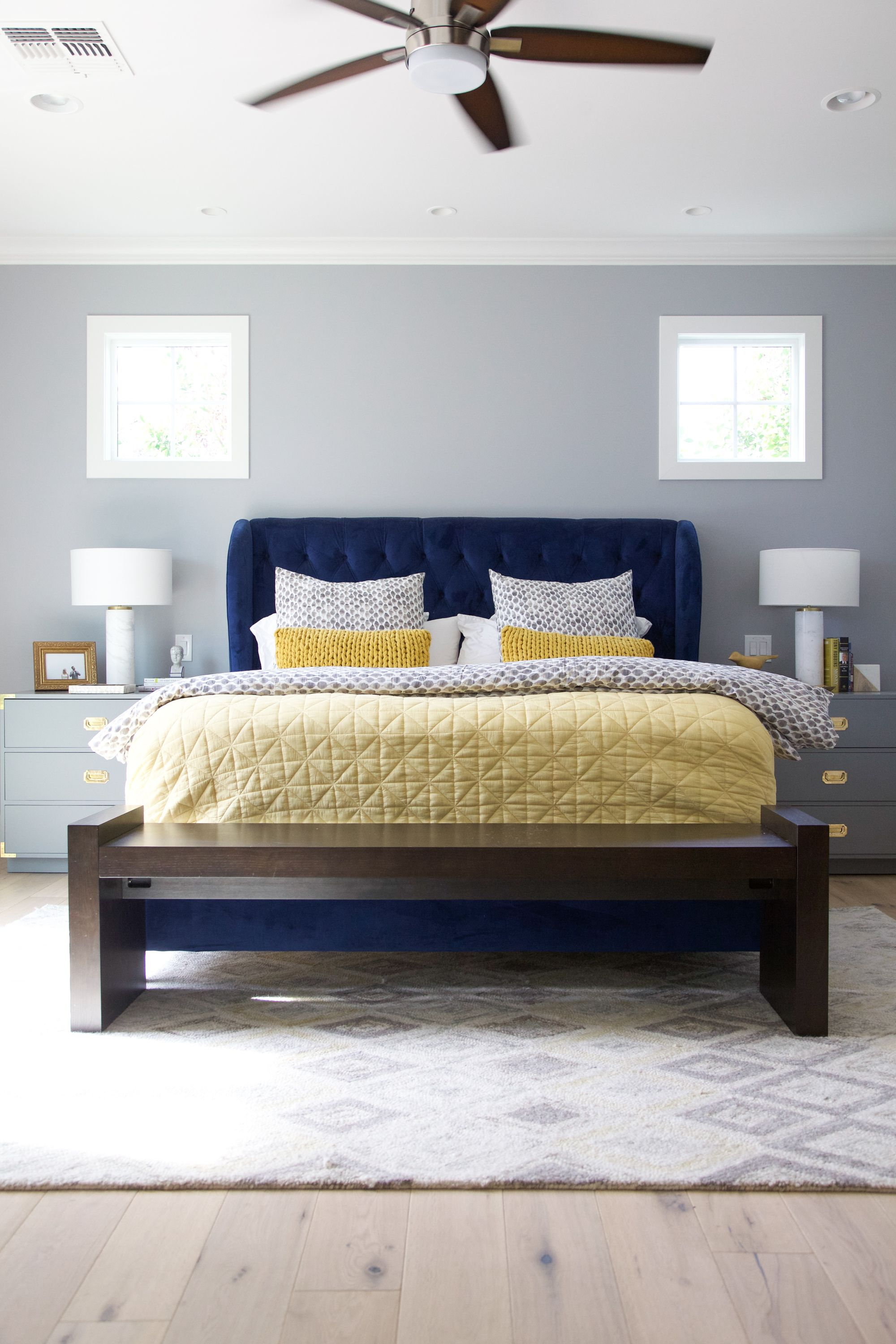 Arcadia Residence Transitional Bedroom With Stunning Royal Blue Upholstered Bed Neutral Gray Wal Blue And Gold Bedroom Blue Bedroom Decor Blue Yellow Bedrooms