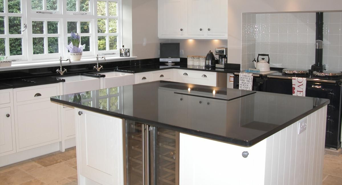 Looking for worktop ideas? Check out this kitchen design. The black and white look works really well.