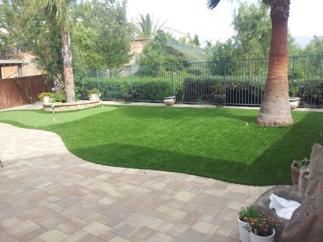 Artificial Grass Maintenance: How To Clean Artificial ... on Backyard Artificial Grass Ideas id=83644