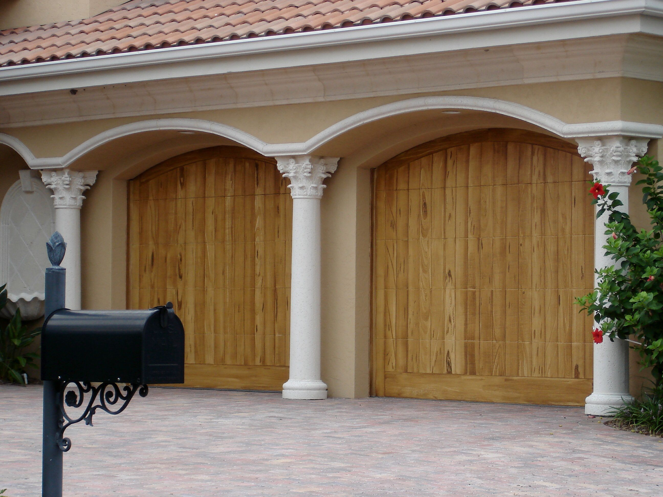 Faux wood grain on metal garage doors backyard design for Wood grain garage doors