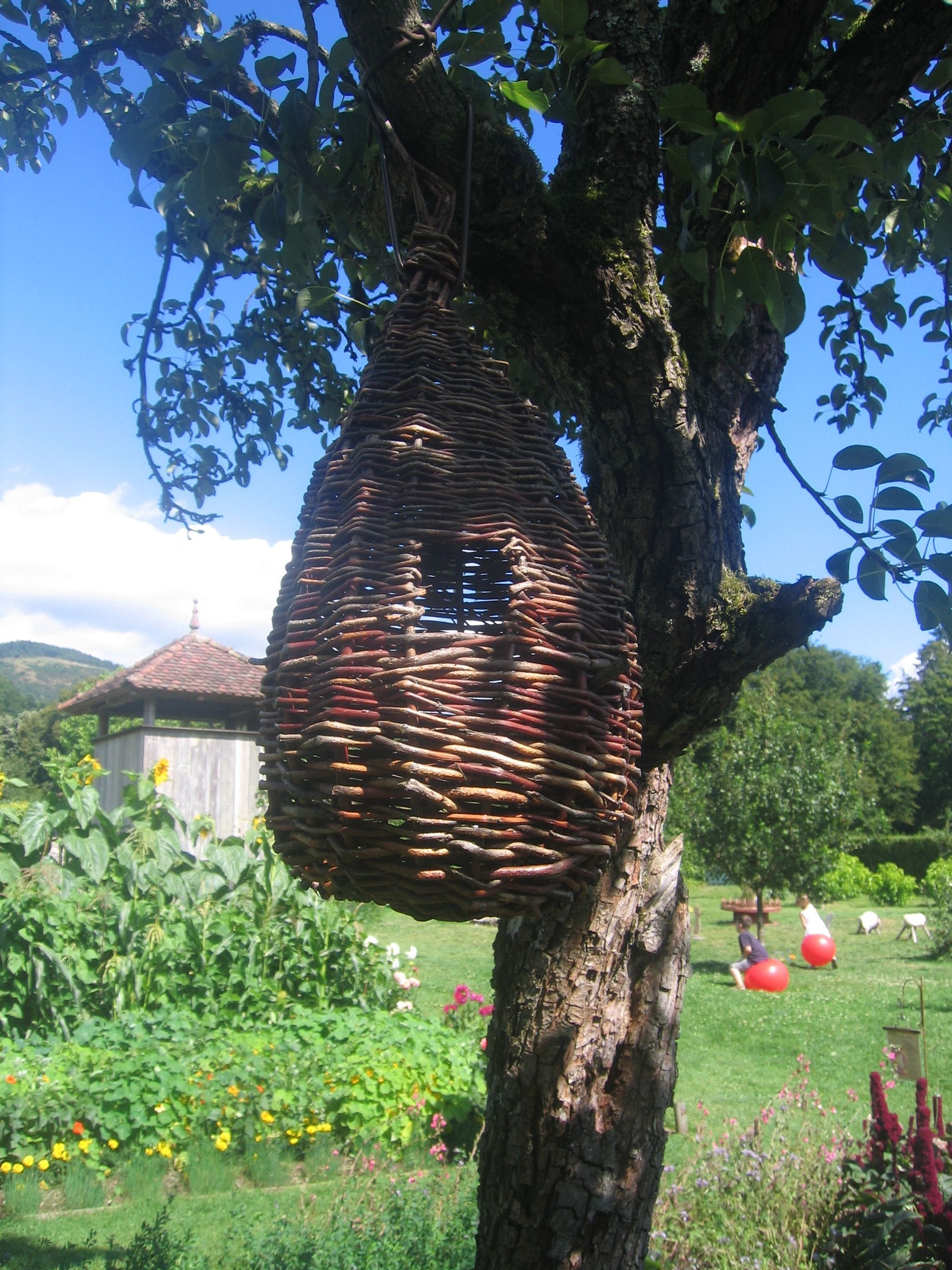 1/28/15 I am grateful for magical baskets in magical trees and magical gardens. (French garden August 2008)