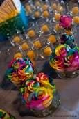 rainbow rose colours just beautifully used in the center pieces