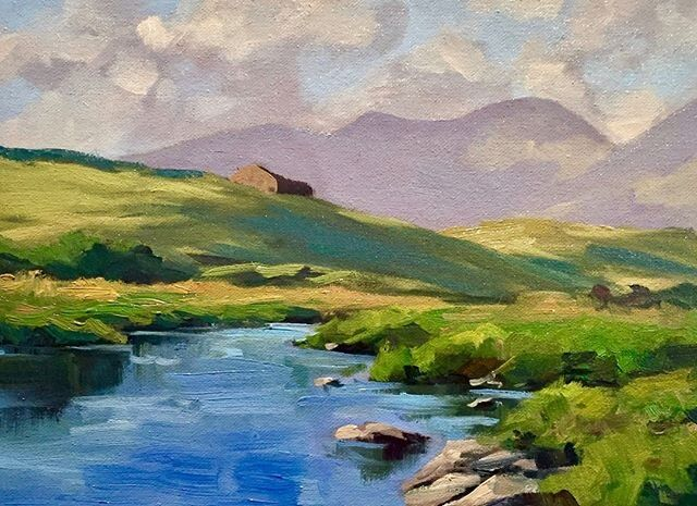 I painted this art work in 2017 in Ballyconneely in County Galway, Ireland and I painted it outdoors en plein air.  The painting features a rolling lush green hills, a river and the 'Twelve Bens' mountains in the distance.  I painted this art work in oils on loose canvas. . . . . . .  #oilpainting #oilpaint #oiloncanvas #impressionism #landscapepainting #pleinair #pleinairpainting #fineart #plein_air_forum #pleinairmagazine #pleinairpainter #allaprima #allaprimapainting #painter #pai