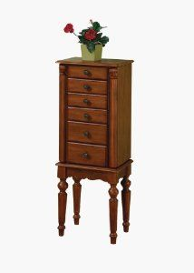 """Powell Lightly Distressed """"Deep Cherry"""" Jewelry Armoire by Powell Furniture. $108.37. Lining is plush black, 100% rayon. Open: 27-1/2"""" x 9-3/8"""" x 46"""" tall. 5 drawers. Lightly distressed """"Deep Cherry"""" finish. Flip top with inset mirror. This petite Jewelry Armoire is sized for economy and function. Features a lightly distressed """"Deep Cherry"""" finish with flip top and inset mirror, scalloped skirt, and spindle turned legs. The top compartment is divided with half ring pads and hal..."""