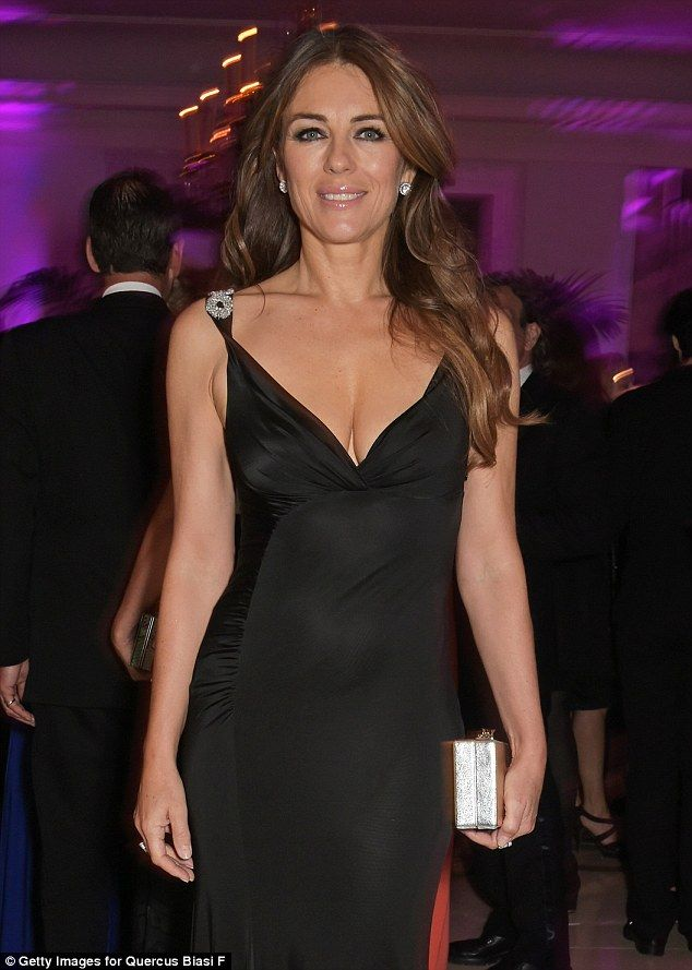Liz Hurley Shows Off Her Sensational Curves In Plunging Black Gown