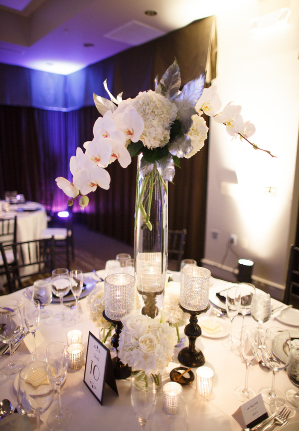 Tall cylinder centerpiece with candles... floral flora bella scottsdale az