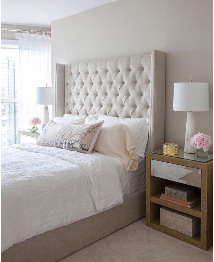 transitional master bedroom. Beautiful Bedroom Features A Beige Tufted Wingback Bed Dressed In White Linen Bedding Flanked By Wood And Mirrored Nightstands Topped With Alabaster Transitional Master