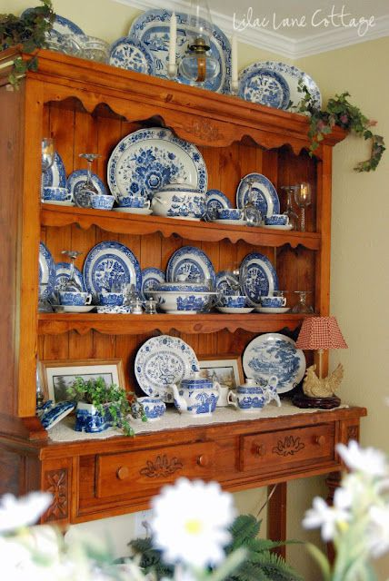 blue and white china displayed in china hutch - note the display on top of the hutch
