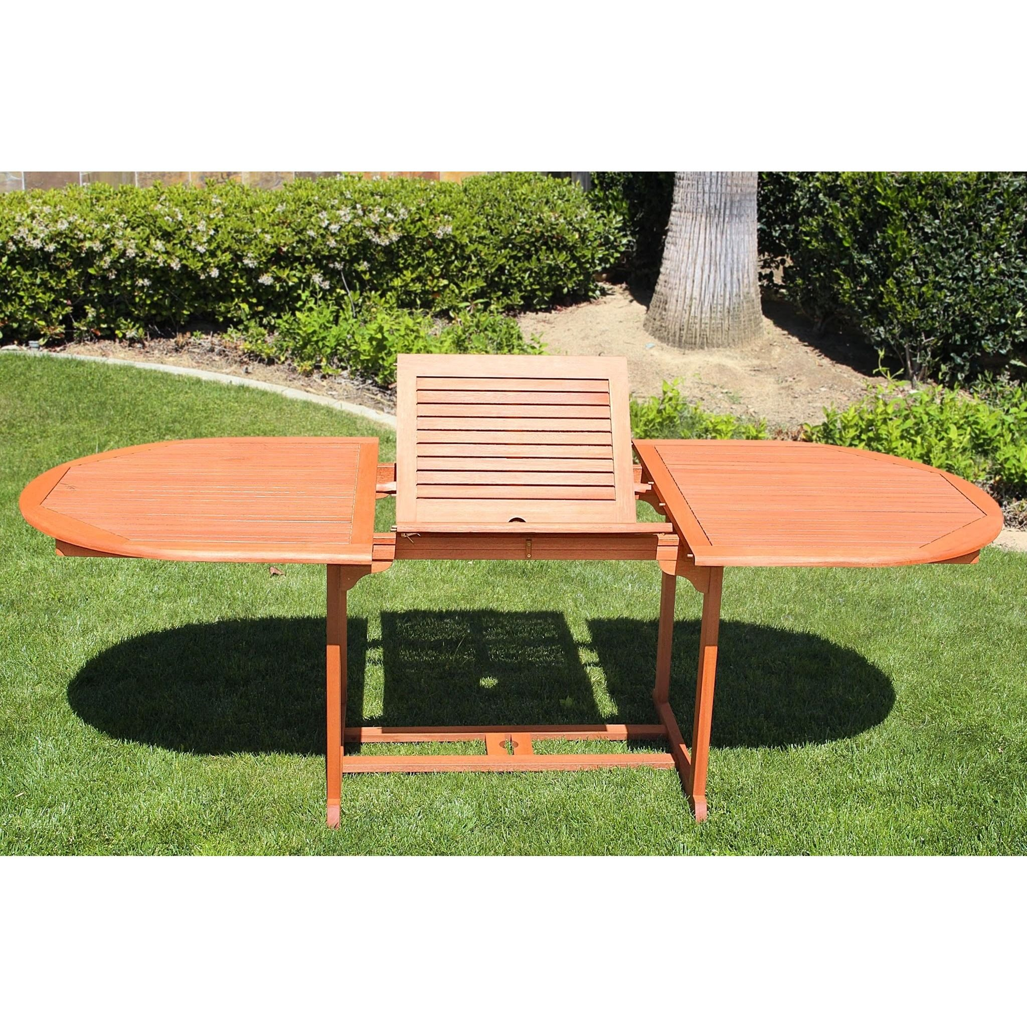 This beautiful oval folding table features a hidden leaf allowing