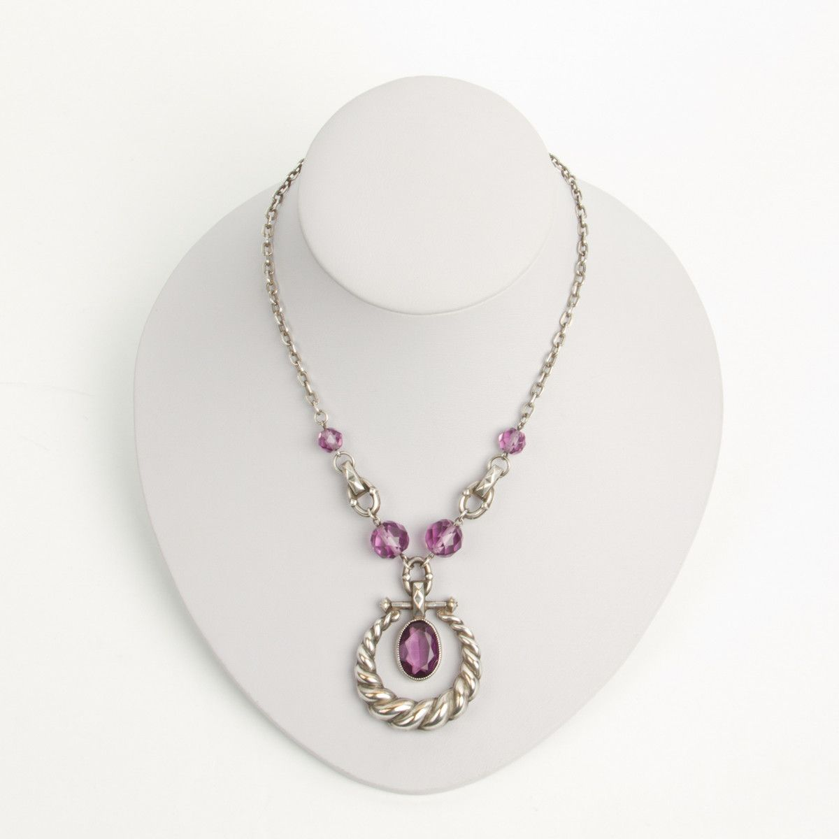 This s pendant necklace is made with silver over brass and
