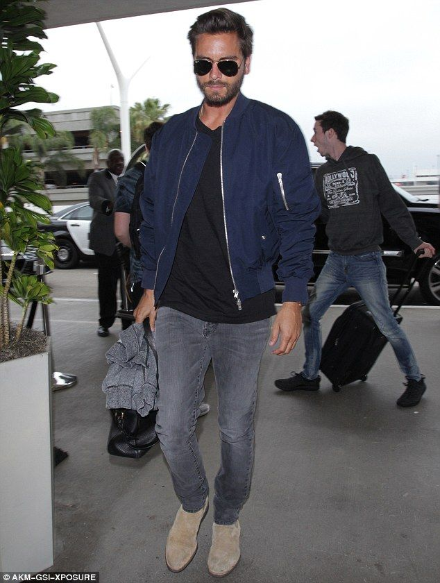 b78985b0bbc Scott Disick wears trendy navy bomber jacket as he jets out of LAX ...