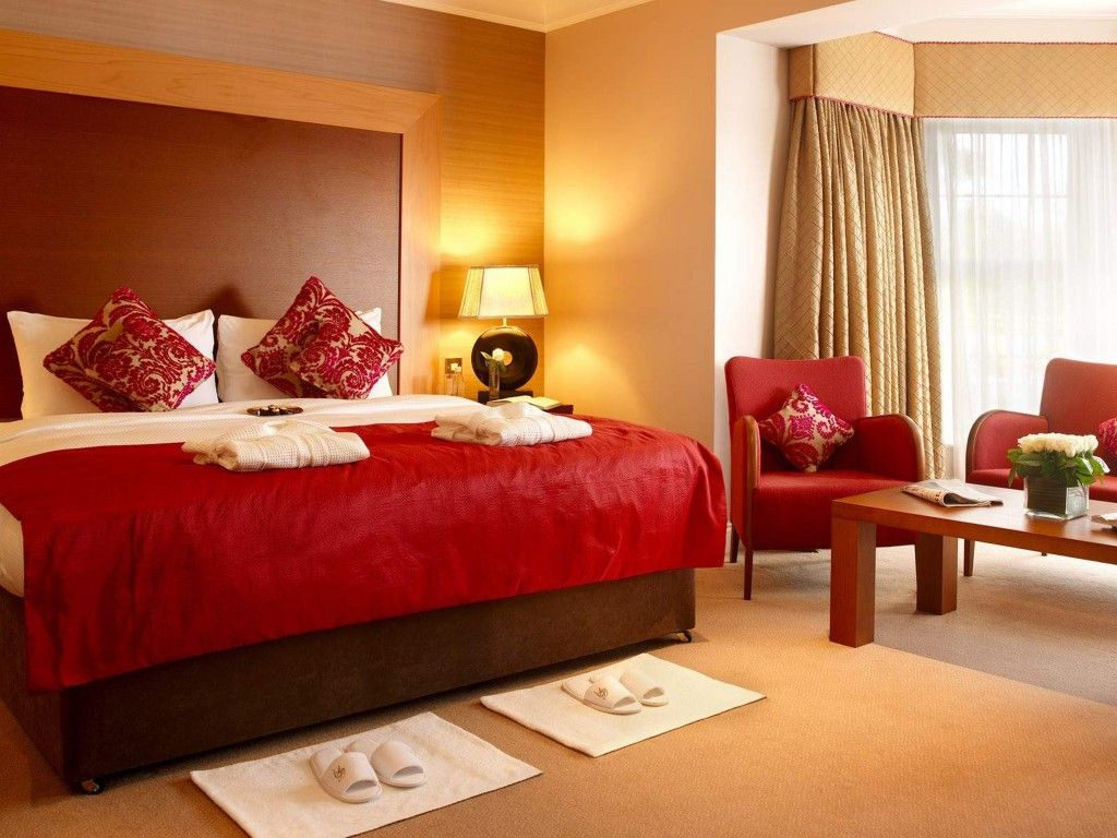 Brown and red bedroom - Amazing Bedroom Interior With Cream Wall Paint Color And Double Small Sofas Design And Red Bed
