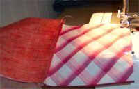 Sew two sets of two squares together to form a row of four squares.